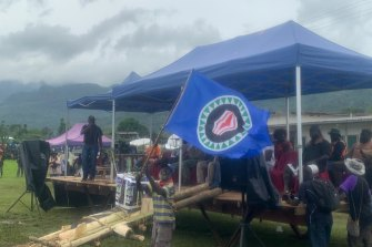 The Bougainville flag, which Marilyn Havini helped design, is waved at a pro-independence rally.