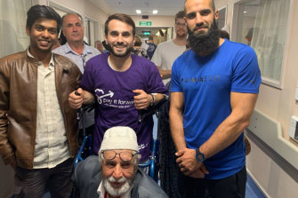 Richmond footballer Bachar Houli (right) visits victims of the Christchurch massacre in hospital.
