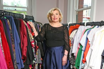 Donna de Zwart, CEO of Fitted For Work, with high quality donated workwear the organisation hands to women seeking work.