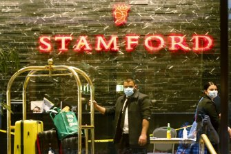 Masked workers inside the Stamford hotel.