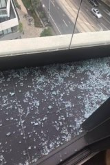 Glass fell onto the balcony of the apartment below.