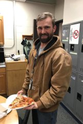 James Scott enjoys his pizza present in Portland, Maine.