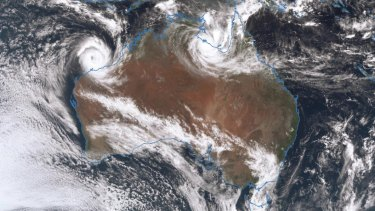 A satellite image shows twin Cyclone systems in the Australian top end, as at 1pm Saturday. Cyclone Veronica (left) and Cyclone Trevor (right).