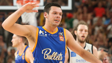 Firing up: Brisbane's Jason Cadee celebrates hitting a clutch three-pointer to extend Brisbane's lead over Melbourne United during their round 12 clash at the Gold Coast Sport and Leisure Centre.