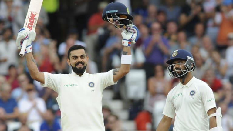 Well supported: Virat Kohli celebrates after scoring a century alongside teammate Ajinkya Rahane.