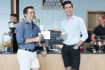 Lawyers Jamieson Doyle-Taylor, left, and Robert Scutella wore shorts to work to fundraise for beyondblue.