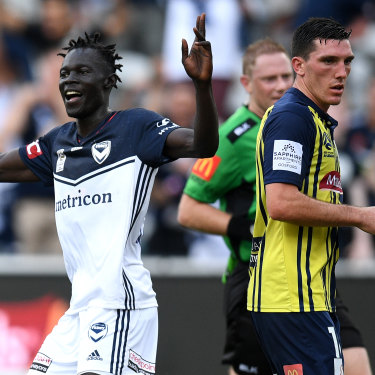 Melbourne Victory's Kenny Athiu (left).