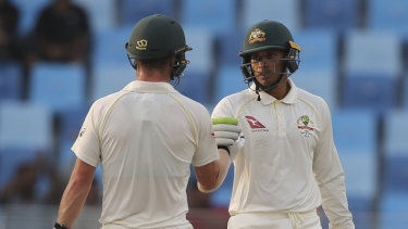 Head (left) and Khawaja will resume in the middle on day five.