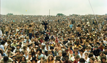 The crowd at Woodstock, including Peter Thompsett (arrow pointing to him).