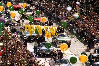 Returning Olympic stars parade down Swanston Street.