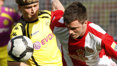 Got their man: Victory have signed German defender Tim Hoogland (right), seen here playing for Mainz in the Bundesliga.