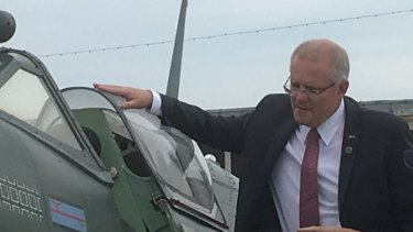 PM Scott Morrison inspects a World War II Spitfire aircraft at D-Day commemorations in Portsmouth, UK.