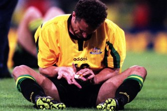 Graham Arnold cut a shattered figure after Australia's 2-2 draw with Iran in 1997 - his last match for his country.