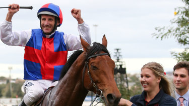 Jockey Damien Oliver returns to scale on Steel Prince  after claiming victory in race 8.