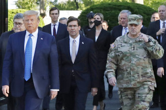 General Milley is pictured on the right, walking with  the president on June 1, 2020, to the photo opp at a church during the Black Lives Matter protests.