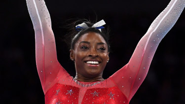 Peerless: Simone Biles waves to the crowd after finishing her floor routine during the women's team finals at the FIG Artistic Gymnastics World Championships in Stuttgart.
