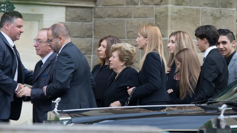 Mourners arrive for the 2016 funeral of gangland lawyer Joseph 'Pino' Acquaro at St Mary's Star of Sea Catholic Church in West Melbourne.