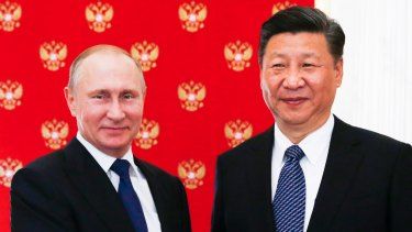 Russian President Vladimir Putin, left, and China's President Xi Jinping were both in Soros's sights.