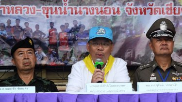 Narongsak Osottanakorn (centre) during a press conference in Mae Sai at the height of the rescue effort.