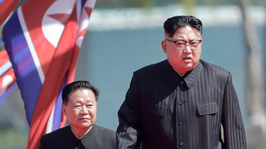 North Korean leader Kim Jong-un, right, and Choe Ryong Hae, vice-chairman of the central committee of the Workers' Party, arrive for the official opening of the Ryomyong residential area, in Pyongyang, North Korea.