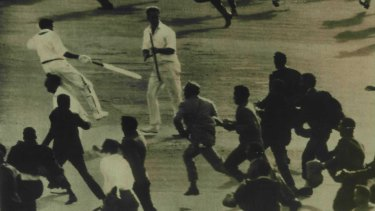 Butcher races for the pavilion after completing the winning run in a 1963 Test against England.