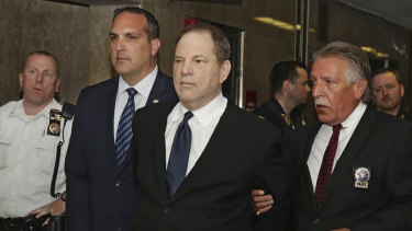 Harvey Weinstein is escorted in handcuffs to a courtroom in New York, on July 9, 2018.