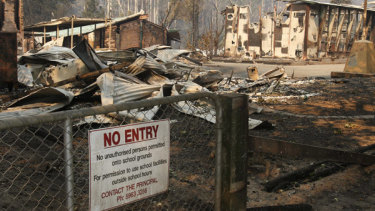 The Marysville primary school in ruins after the 2009 bushfires. Women have more to fear than Mother Nature when natural disasters strike.
