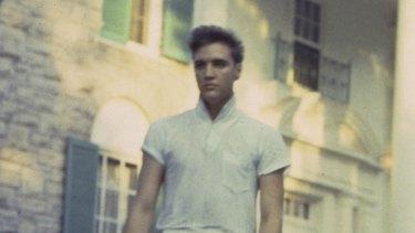 Elvis Presley strolls the grounds of his Graceland estate, 1957.