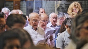 Parishioners signing along to hymns at St Paul's Cathedral.