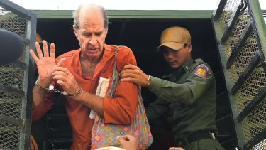 James Ricketson exiting a prison van as he arrived at the Phnom Penh Municipal Court for a court appearance in June, 2018.