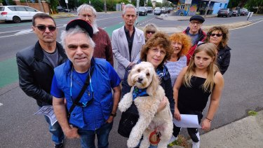 Save Inkerman members including Robyn Taft  (right, with dog) and Moishe Wolf, front left, oppose a bicycle super trail going down Inkerman Road, Caulfield North.