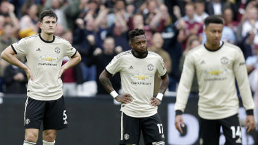 Manchester United players look on after West Ham's second goal.