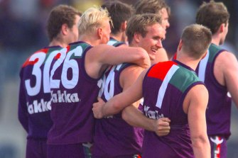 Foundation Docker Quenton Leach (centre) has died from cancer.