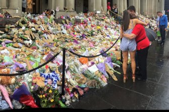 People leave tributes in Bourke Street Mall in January 2017.