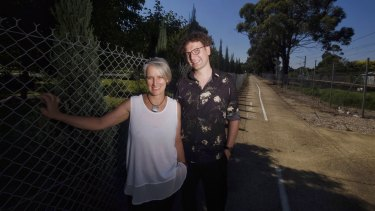 Artist Malcolm Angelucci and Majella Thomas at the bike path next to the Fawkner Cemetery.