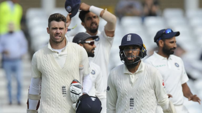 Dismissed: England's Adil Rashid, right, and James Anderson leave the field at the end of the third cricket Test between at Trent Bridge.