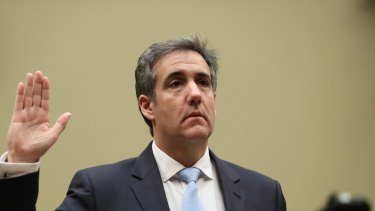 Michael Cohen takes the oath ahead of his congressional testimony.