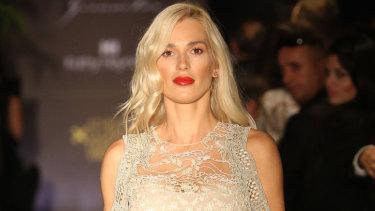 Viktoria Karyda wears Kathy Hendyl down the catwalk as her husband John Macris is gunned down.