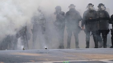 Police stand near tear gas during a demonstration in Atlanta over the death of George Floyd, who died on May 25 in Minneapolis.