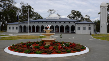 Police have charged a man after he allegedly rammed his car into the front gates of a mosque.