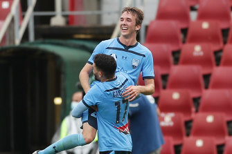 Calem Nieuwenhof was mobbed by his teammates after scoring his first A-League goal on Saturday.