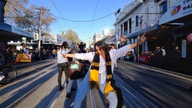 Revellers started to filter into Swan Street after the siren, with police watching on.