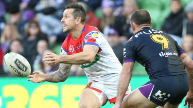 Brought back to Earth: Mitchell Pearce under pressure from his old Origin nemesis Cameron Smith.