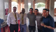 Cricket South Africa officials Clive Eksteen and Altaaf Kazi pose with spectators wearing Sonny Bill Williams masks at St George's Park in 2018.