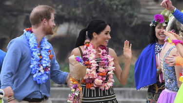 Britain's Prince Harry and Meghan, Duchess of Sussex meet a local surfing community group, known as OneWave, raising awareness for mental health and wellbeing at Bondi Beach in Sydney on Friday.