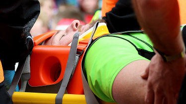 Horne is stretchered off during the Aviva Premiership match at Welford Road, Leicester, in April.