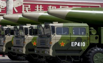Military vehicles carrying DF-26 ballistic missiles drive past Tiananmen Gate during a military parade in Beijing to commemorate the 70th anniversary of the end of World War II.