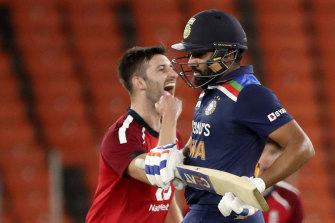Mark Wood celebrates the wicket of India's Rohit Sharma.