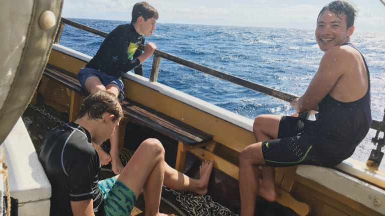 Abdul, with Lucas and Toby, on a sailing boat trip. Now boat trips are fun; this boy has come a long way.