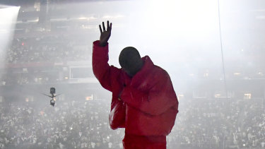 Kanye West onstage during a Donda listening event in July.